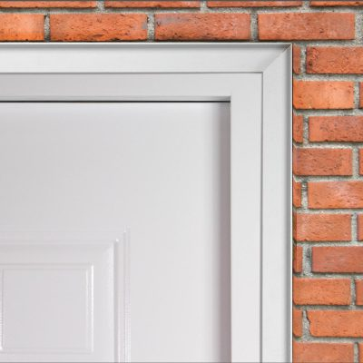 Close up of security trim kit fitted to a latham's steel door