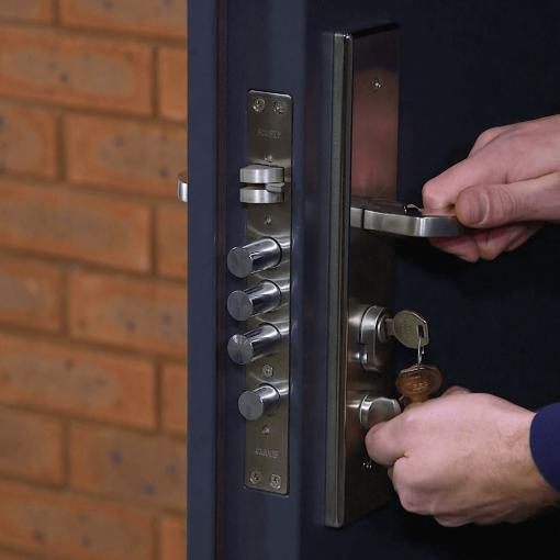 High security steel door lock and handle close up