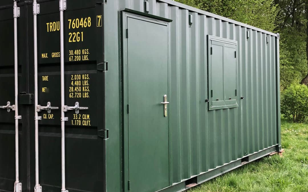 Converted shipping container with door and window