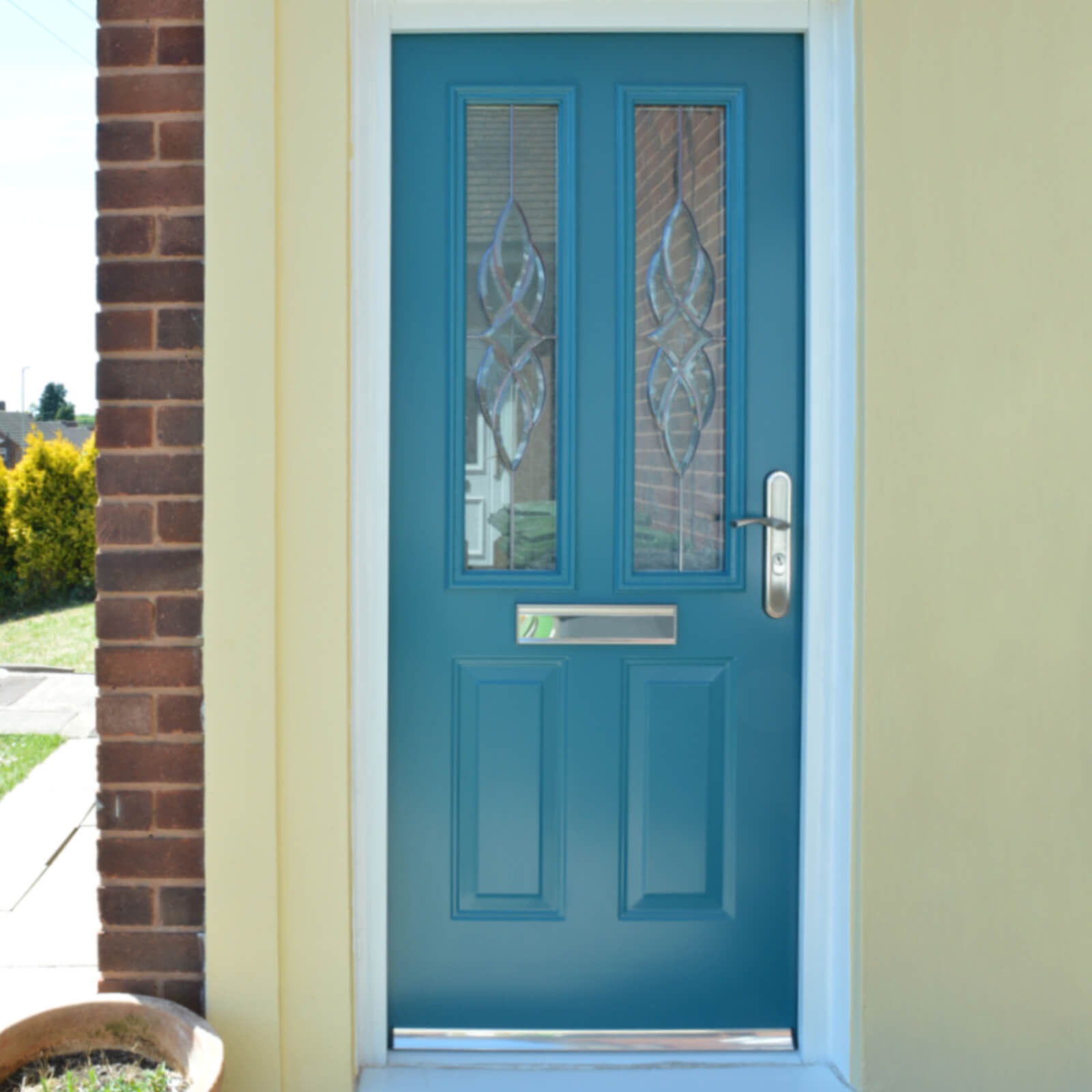 Turquoise traditional front door with patterned glass