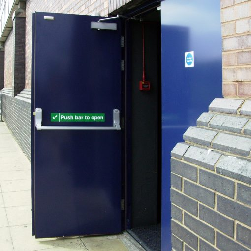 An open, dark blue fire exit door showing push bar and push bar to open sticker