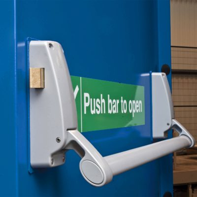 Push bar to open sticker on a blue fire exit door