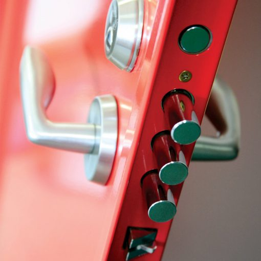 Close up of locking system on a red steel door