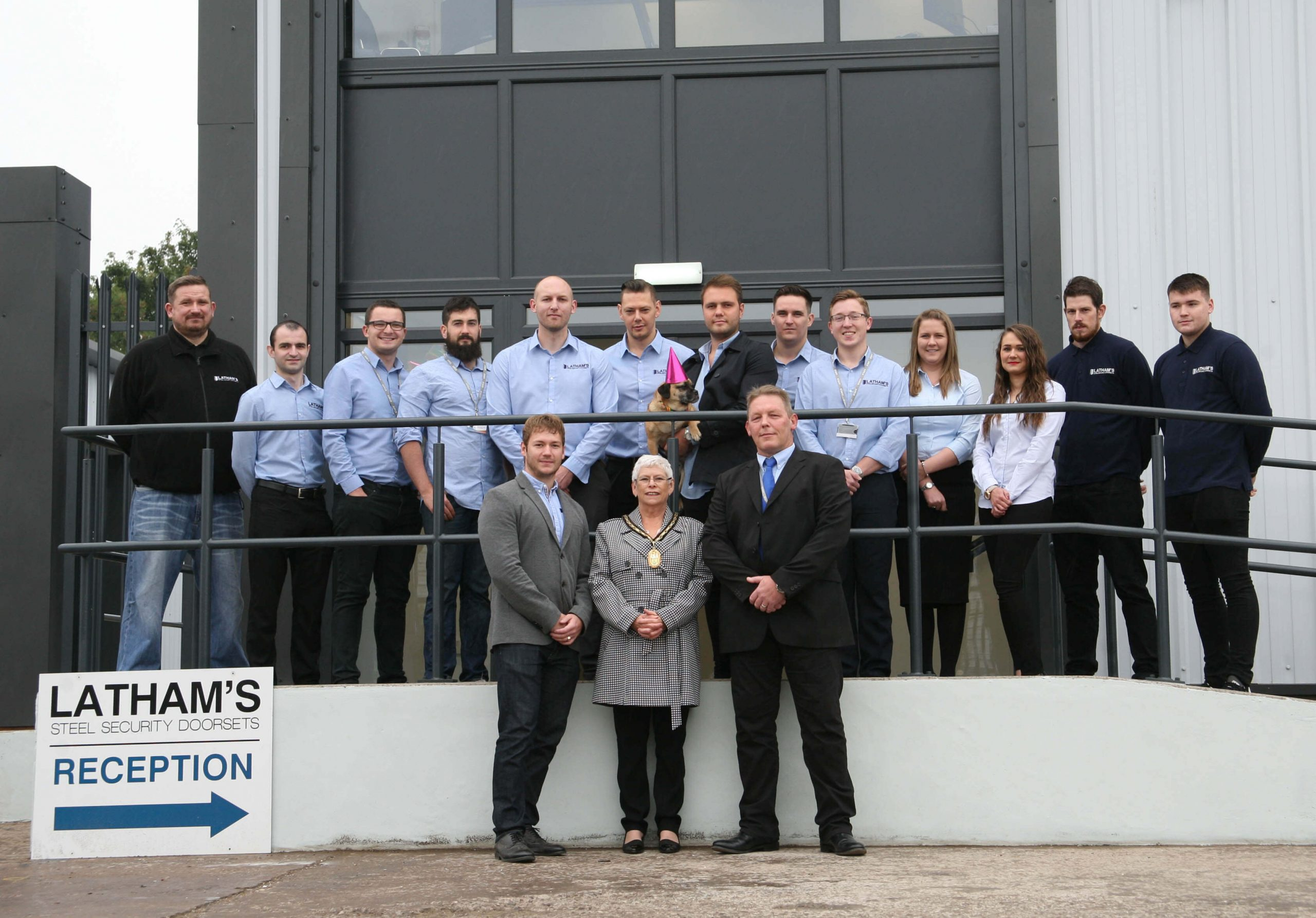 Latham's staff, and Sandwell Deputy Mayor outside their new offices