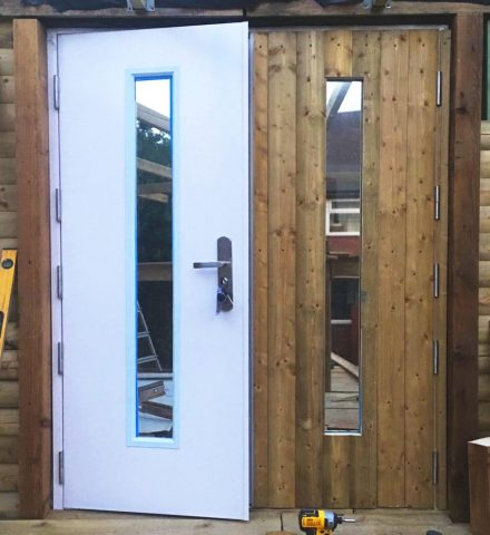 picture of an Ultra Double Door with one door blank and one with timber cladding