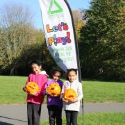 3 girls at the Let's Play Sandwell session with carved pumpkins in Tividale Park
