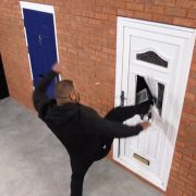 Image of a uPVC door under attack