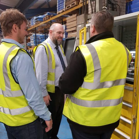Alex and Dale from Lathams showing Jan Britton around the manufacturing facility