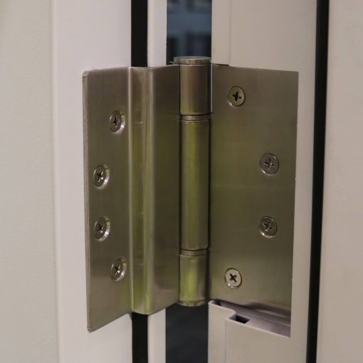 Hinges installed on a high security panelled steel door