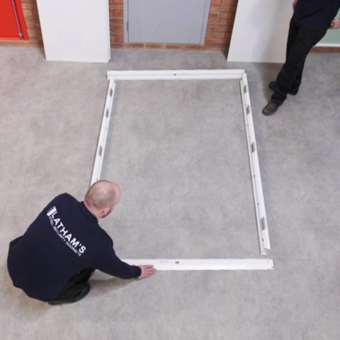double door frame pieces laid out on the floor