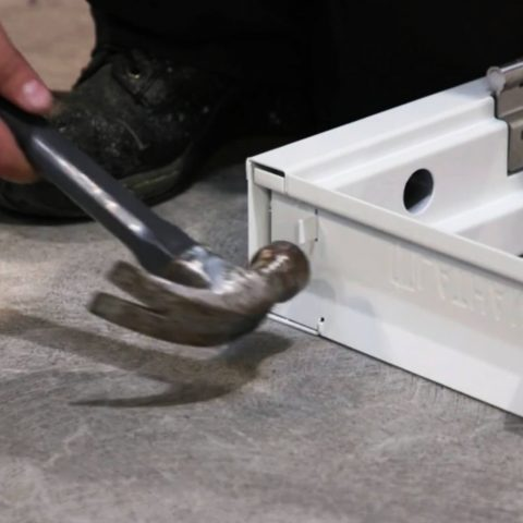 frame tab being hammered into position