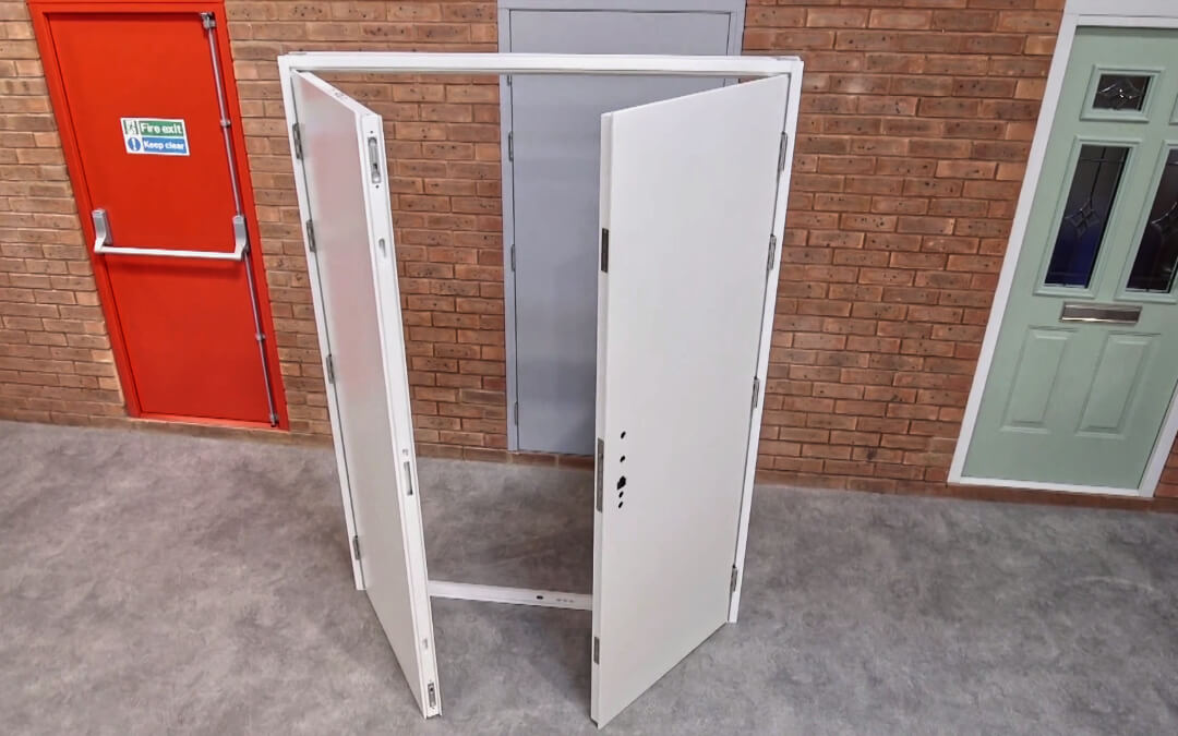Double door frame assembled with wall of three steel doors in the background