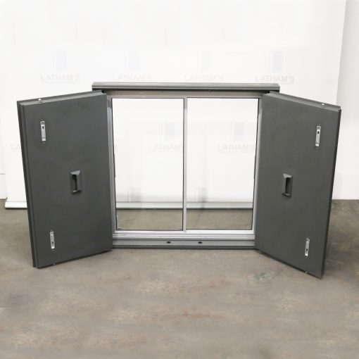 Shipping container window with glazing installed