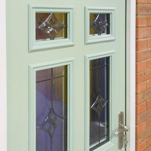 close up shot of the glazing panels in a chartwell green front door