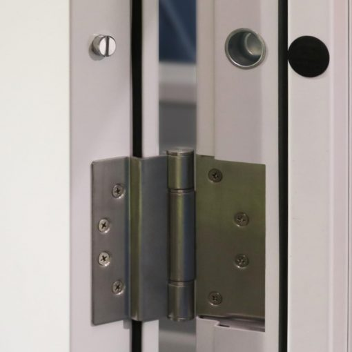 Hinges and dog bolts on high security steel door