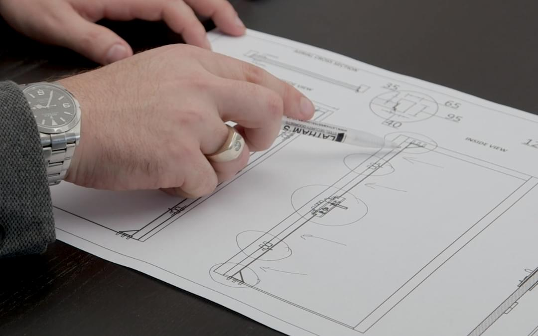 a hand using a pen to point to a product development diagram