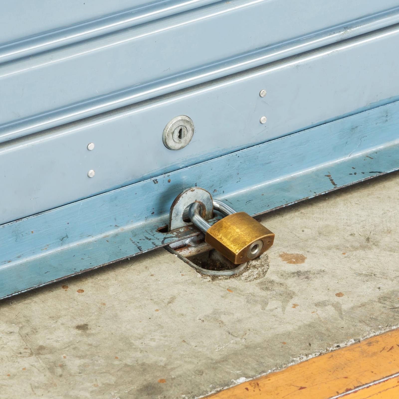 Ground lock on a garage door