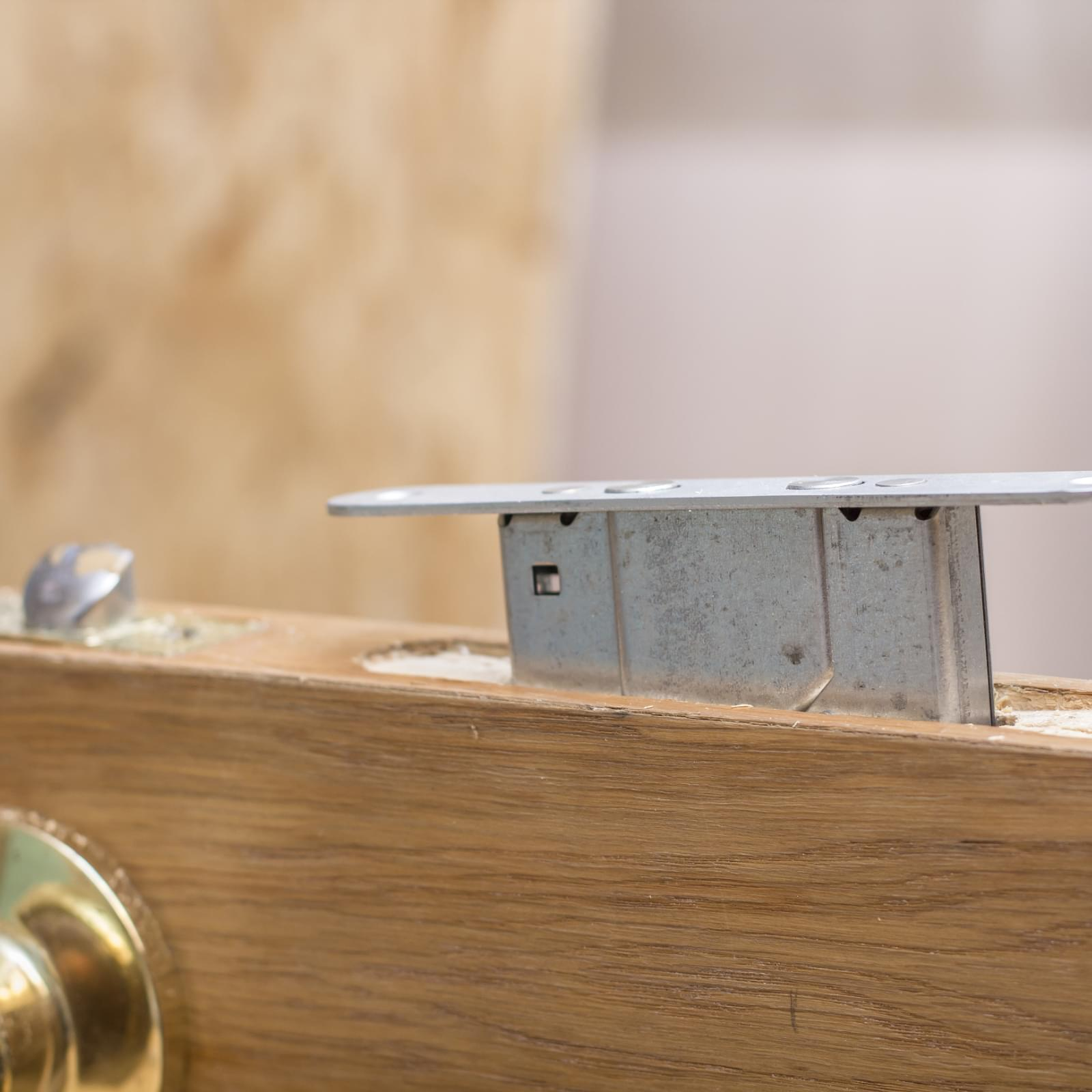 close up of a mortice deadlock being installed in a wooden door