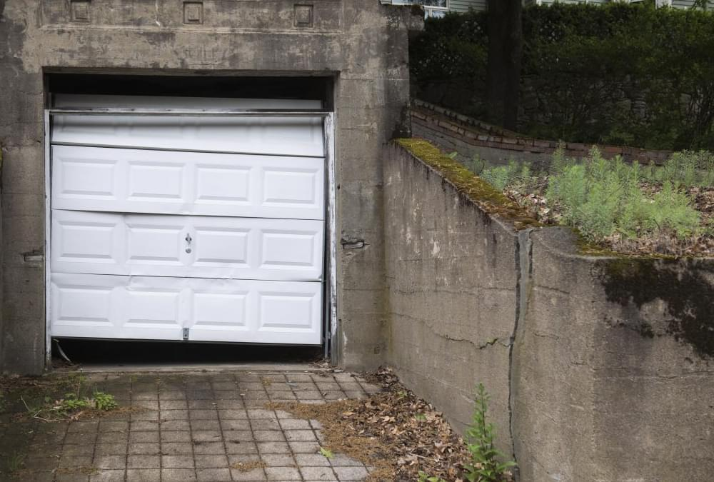 Broken into garage door